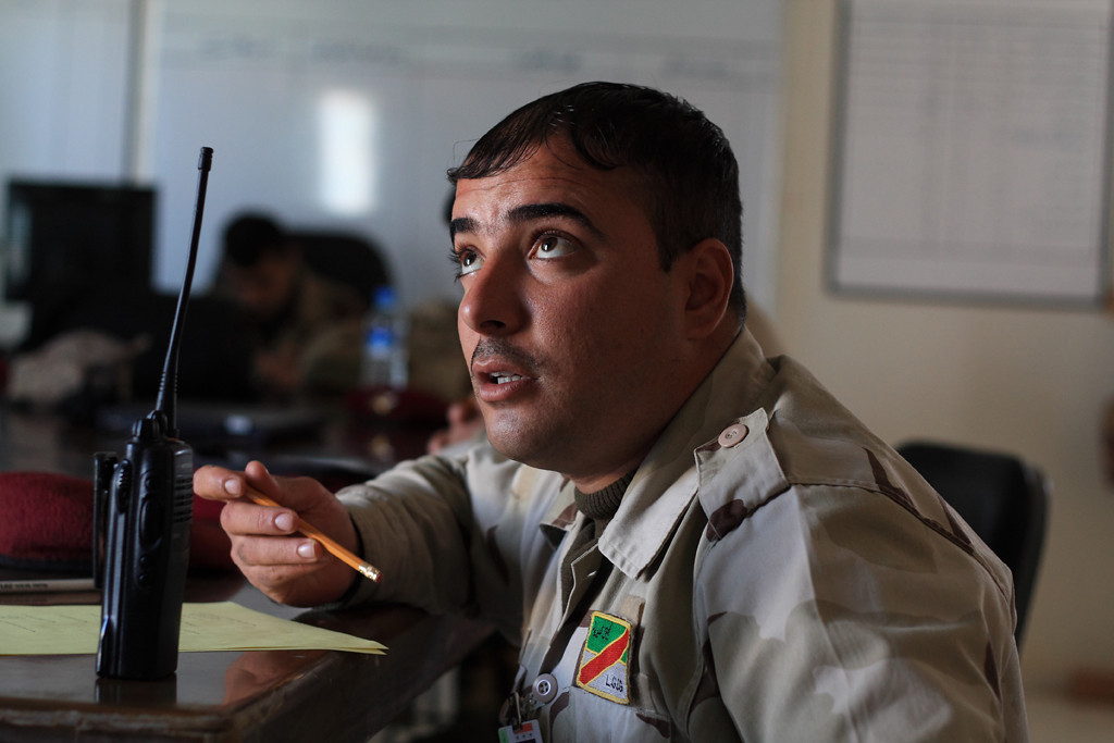 A member of the Iraqi Army, and student at the Marine Military Transition Team's training group at Al Asad Air Base, Iraq, asks a question during a class. December 9, 2009.