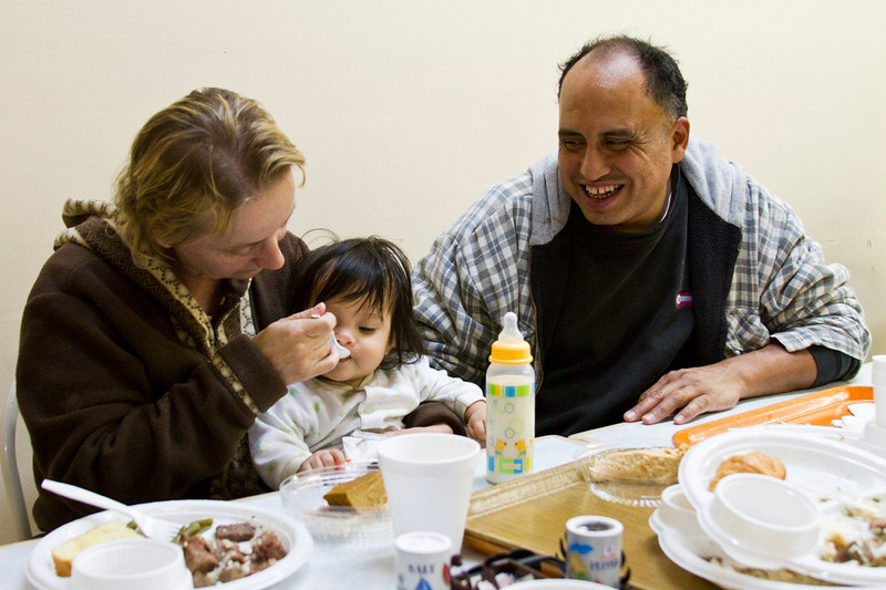 In Jackonsville, NC, two parents come to the Onslow County Soup Kitchen with their daughter to enjoy a hot meal on Saturday morning. November 12th, 2010.