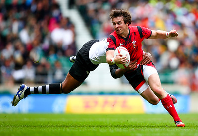 Luke Morgan of Wales is tackled by Jasa Veremalua of Figi during the pool match between Wales and Figi during day one of the HSBC London Sevens at Twickenham Stadium on May 21, 2016 in London, United Kingdom.