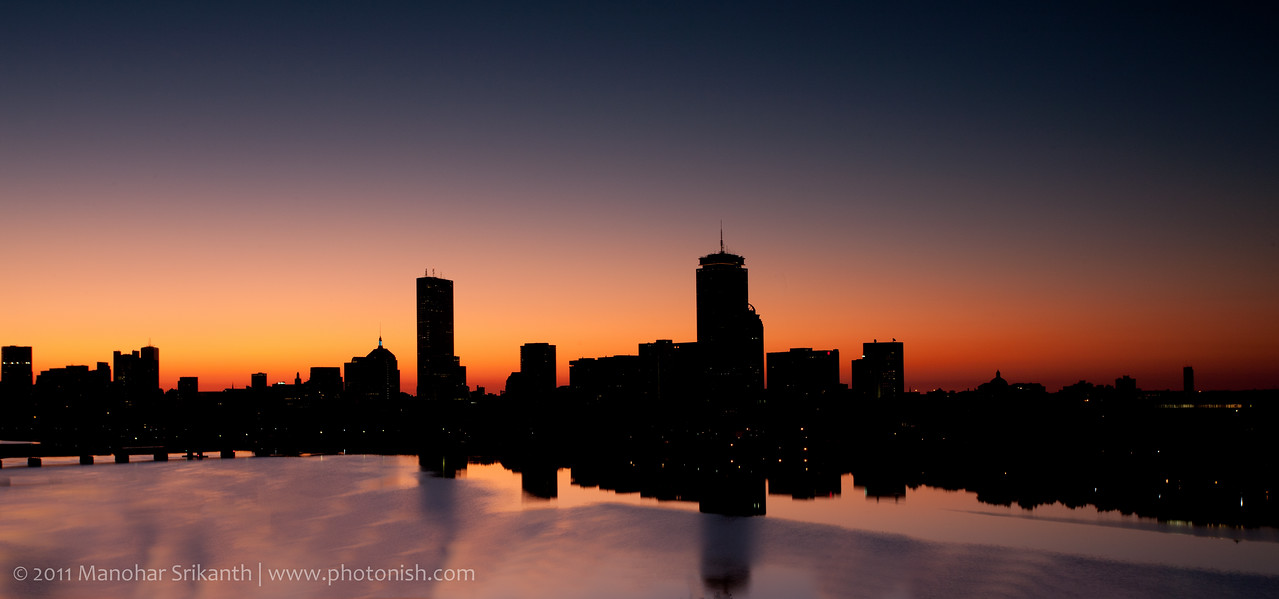 Boston skyline reflected in the Charles river on a beautiful morning.