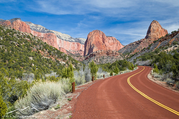 One of my favorite shots- the red roads in this part of the park look surreal with the red sandstone peaks.