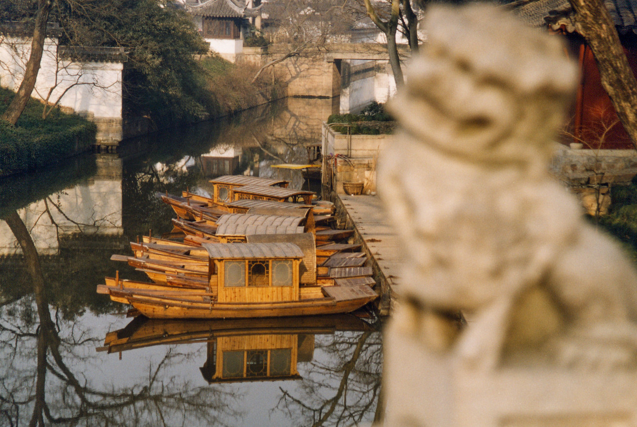 Moored boats outside Huqiu Temple await passengers from long ago. (Suzhou Reflections)