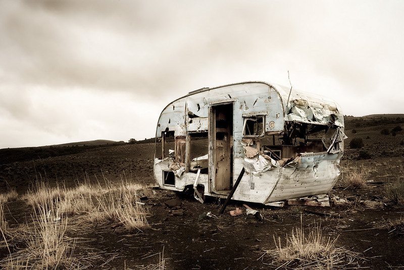A travel trailer slowly decays along the road to Bodie.