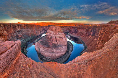 This photo is of Horseshoe Bend located on the edge of the Navajo Nation next to Page Arizona. To reach this location you walk up a steep incline of sand to you come to this spectacular view of Navajo sandstone. You are looking over the edge at a 1000 foot drop to the bend of the Colorado River.