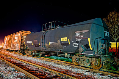HDR rendition (in camera) of a couple of railcars near the paper processing plant.