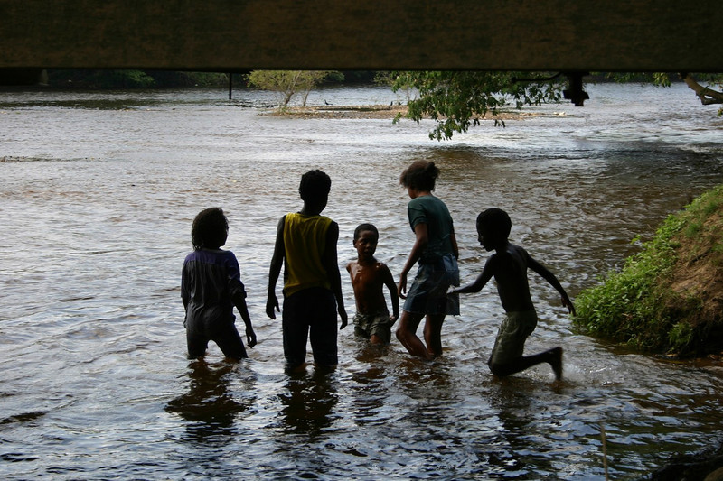 Children playing in the Macal River. San Ignacio, Cayo District, Belize, 2006 © Copyrights Michel Botman Photography