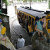 Local Artist with his wife and son along the trolley line, Santa Theresa, Rio, Brazil (2004) © Copyrights Michel Botman Photography
