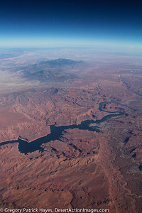 Lake Powell with the Henry Mountains in the middle ground and the Canyons of Southern Utah and Northern Arizona.