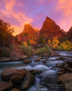 """GRAND DAWN""Zion NPA spectacular display of light frames the Court of the Patriarchs, photographed from the shore of the Virgin River in Zion National Park.© Chris Moore - Exploring Light PhotographyPURCHASE A PRINT"