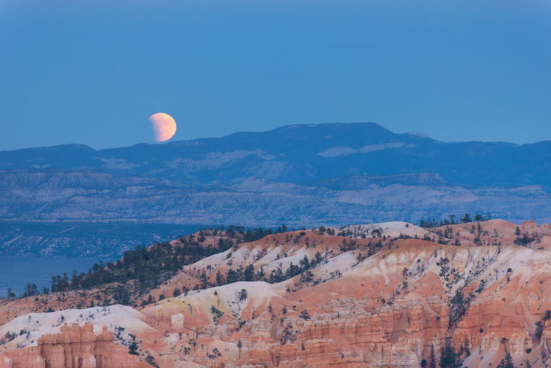 Eclipsing Moon Over Bryce Canyon.
