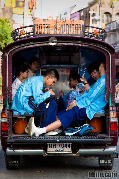 "Way Home<br /> Chiang Mai, Thailand<br /> <br /> A group of students seen inside a songthaew (Thailand's public passenger truck, which literally means ""two rows"") on their way home after school."