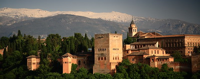 View of the Alhambra with the Sierra Nevada mountains.