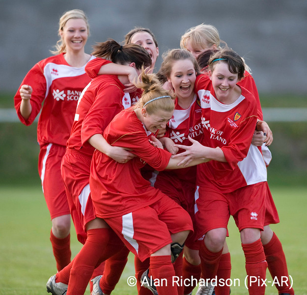 Pic Alan Richardson Dundee Pix-Ar.co.uk .<br /> The Bank Of Scotland Girls Football senior Shield Under 18's Final held at Forfar West End The Mintlaw team celebrate with Jody Buchan who scored the winning penalty