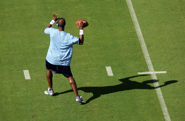 Tennesse Titan Vince Young warms up before a Game with the Dallas Cowboys in 2006.