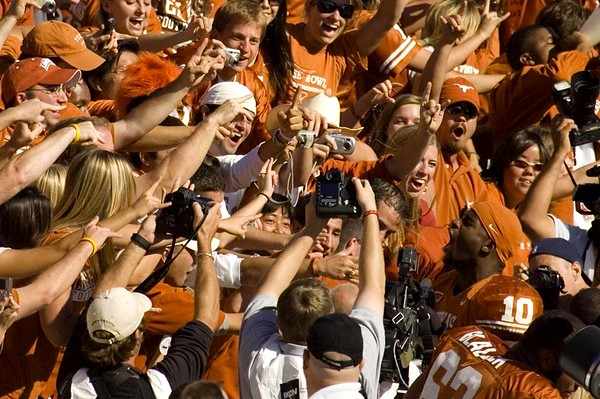 Vince Young celebrating with the crowd after defeating the OU Sooners in the 2005 Texas/OU game at the Cotton Bowl in Dallas, Texas. Texas went on to win the National Championship against the USC Trojans.