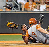 Arizona State catcher Austin Barnes, back,  tags out Texas' Tant Shepherd for the third out in the ninth inning as Shepherd tried to score from third on an pop fly caught by Arizona State's rightfielder  Matt Newman during Game 2 of the NCAA Super Regional college baseball tournament, Saturday, June 11, 2011, in Austin, Texas. Texas won 5-1. (AP Photo/Michael Thomas)