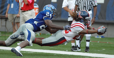 Ole Miss's Dexter McCluster (right) dives for the pylon and comes up just short as Memphis's Akeem Davis defends.