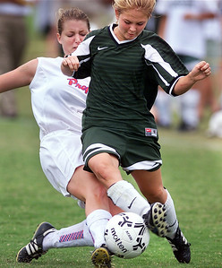 -  -Caption: Jackson Prep's Kirke McNeel (left) and Pillow Academys Morgan Woods battle for the ball during Thursday afternoon's MPSAA State Championship at Jackson Prep. Pillow Academy went on to win the game 1-0.