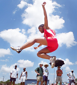 -  -Caption: Peyton Harris, 10, of Town Creek, Ala. soars through the air while competing in the long jump competition Saturday afternoon during day 3 of the USATF Region VI Junior Olympic Track and Field Championships at Jackson State University.