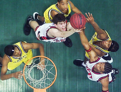 -  -Caption: Corinth's Grant Roberts (center, in white) and Galvin Davis (lower right) fight for a rebound with Holly Springs players (from left, in yellow) Jeffrey Jones, Kenny Dawkins and Deuntrell Mosley during Wednesday's MHSAA playoff game at the Mississippi Coliseum.