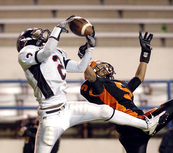 Lumberton's Derell McLemore (left) picks off a pass intended for Calhoun City's Aaron Thompson late in the fourth quarter of Friday's MHSAA Class 2A championship game at Mississippi Veterans Memorial Stadium.
