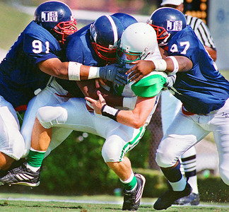 -  -Caption: Mississippi Valley quarterback Rob Harding struggles to hang on to the ball as he is sandwitched between Jackson State defenders (left to right) Rahmin Hammock, Leroy Mathews, and Joshua Matthews during Saturday's game at Mississippi Veterans Memorial Stadium.