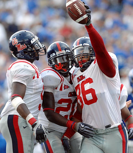 Ole Miss defensive end Greg Hardy (right) celebrates with teammates following a second-half fumble recovery deep in Memphis territory.