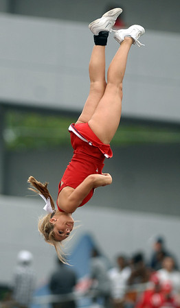 An Ole Miss cheerleader flips though the air during a football game at Vaught-Hemingway Stadium in Oxford.