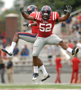 Ole Miss's Damien Jackson and Mike Marry celebrate a defensive stand during the first half of Saturday's game against BYU in Oxford.