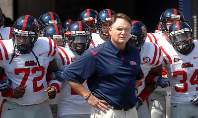 Head Coach Houston Nutt waits with his players before making their entrance into the Liberty Bowl Sunday afternoon as the Rebels opened their season against the University of Memphis.