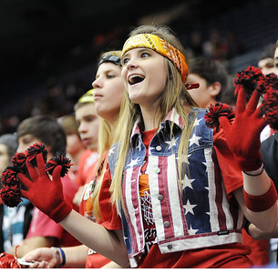 A colorfull-clad Corinth High School fan cheers on her team during the first half of  Monday afternoon's MHSAA Class 4A game against Bay High at the Mississippi Coliseum in Jackson.  Corinth went on the defeat Bay to advance in the state championships.