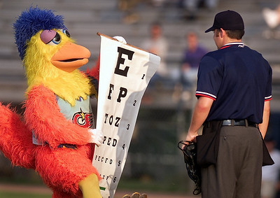 Home plate umpire Kyle Humphrey, of Muskogee, Okla., takes some good-natured ribbing from the famous San Diego Chicken who was at Smith-Wills Stadium to entertain fans at Sunday night's game between the Jackson Senators and the Pensacola Pelicans.