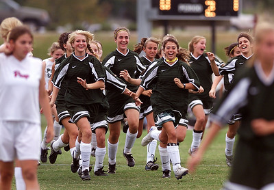 Pillow Academy players sprint from the bench to celebrate with their teammates on the field Thursday afternoon after defeating Jackson Prep for the MPSAA State Championship.
