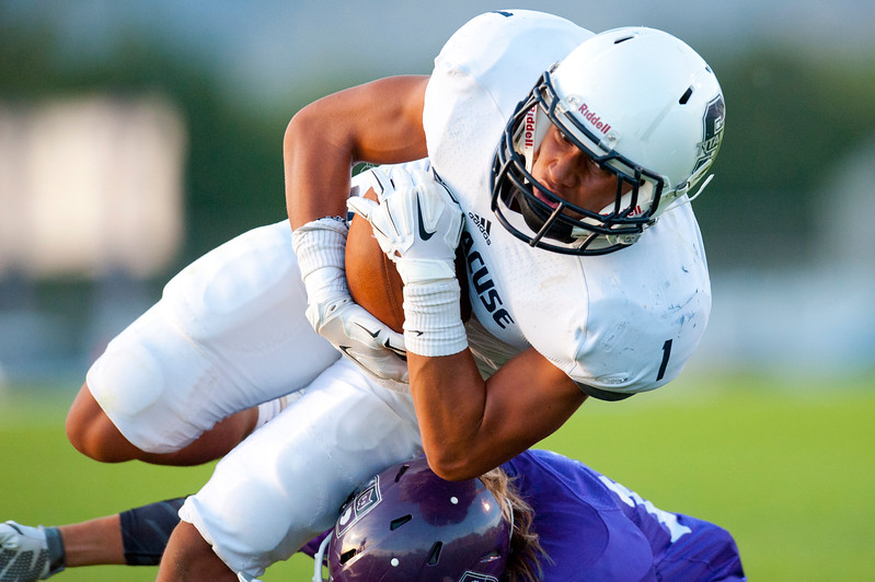 Syracuse Wide Receiver NJ Mo'o makes a atheltic dive after catching the ball for positive yardage. At Box Elder High School on August 28, 2015