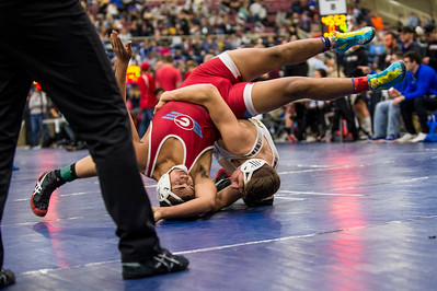 Heston Percival (bottom, right), of Davis High, flips over Robert Tabile (left), of Granger High, to gain control in the 5A divisional tournament to qualify for the state wrestling championships at the Legacy Events Center in Farmington, on Thursday, February 2, 2017.