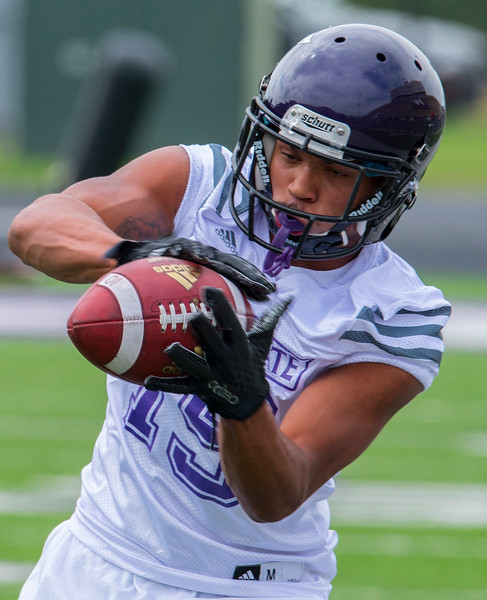 Receiver Brandon Sherwin (19) eyes the ball into his hands during ball catching drills at Stewart Stadium at Weber State University on August 5, 2016