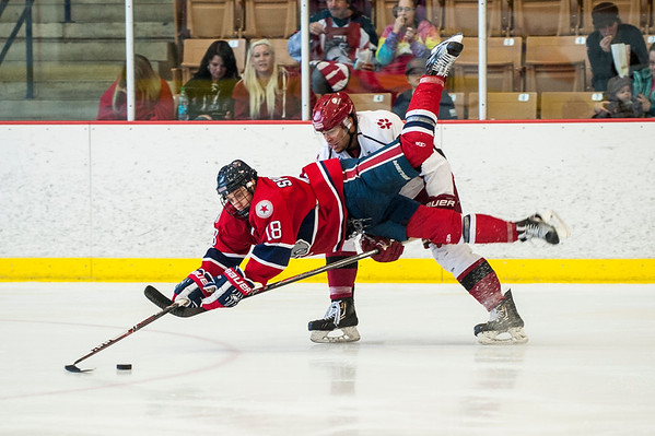 Matus Spodniak (18), of the Ogden Mustangs goes airborne fighting for position against Gabriel Romero (2), of the Casper Coyotes at the Ogden Ice Sheet in Ogden on November 1, 2015.
