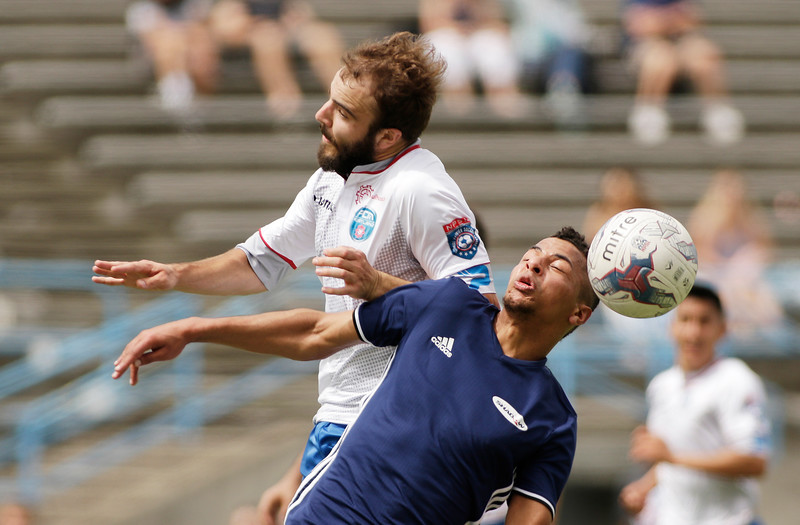 FCM Portland defender Jordan Selland, left, and Spokane Shadow forward Zack Hamer go after the ball during the first half of a National Premier Soccer League Northwest Conference game at Spokane Falls Community College in Spokane, Wash., Sunday, June 18, 2017. (Young Kwak/The Inlander)
