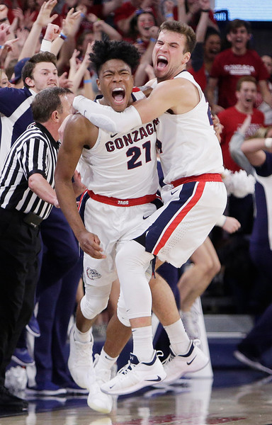 Gonzaga forward Rui Hachimura (21) celebrates his go-ahead basket with teammate Corey Kispert during the second half of an NCAA college basketball game against Washington in Spokane, Wash., Wednesday, Dec. 5, 2018. Gonzaga won 81-79. (AP Photo/Young Kwak)