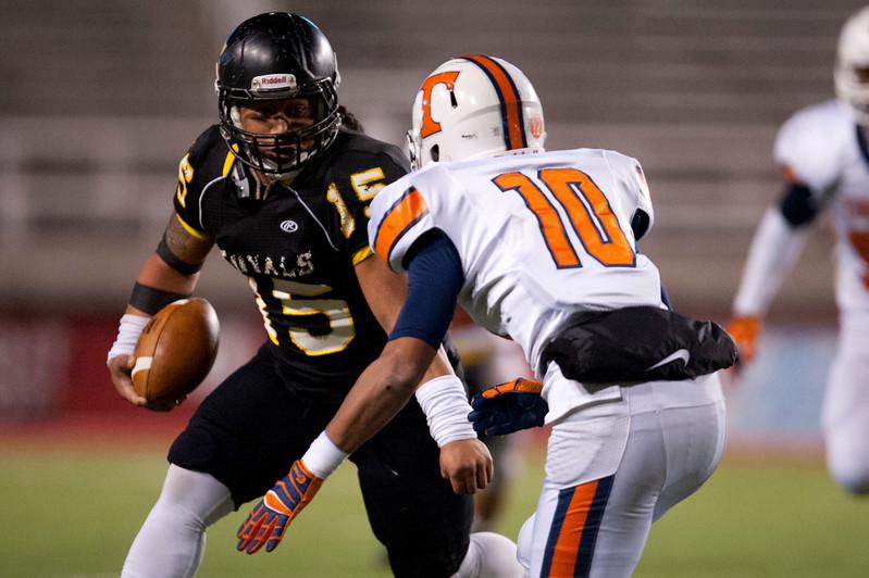 Baby Tee Eteuati #15 tries to get around defender Isaiah Holloway At Rice-Eccles Stadium in Salt Lake City. On November 21, 2014