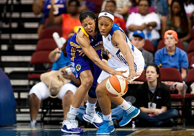 WNBA: Los Angeles Sparks' forward Candice Parker (3) and New York Liberty's guard/forward Alex Montgomery (22).