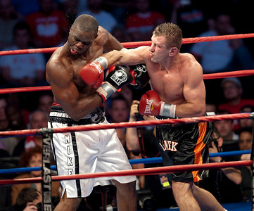 Michael Grant (white shorts) and Tomasz Adamek (black shorts) fight during their 12 round IBF International/NABO Heavyweight Championship bout at the Prudential Center in Newark, New Jersey.