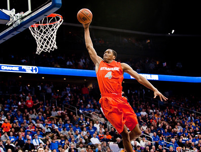 NCAA: Syracuse's forward Wes Johnson (4) sky dunks during Big East Conference action against the Seton Hall Pirates at the Prudential Center in Newark, New Jersey.