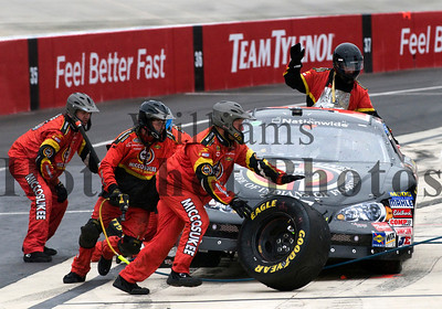 Driver Martin Truex, Jr. (1) pit stop crew during the NASCAR Nationwide Series 200 at the Dover International Speedway in Dover, DE.