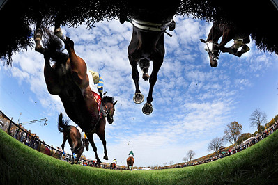 Horses clear a hurdle during The Foxbrook Champion Hurdle race at the 92nd annual Far Hills Race meeting at Far Hills Farm sponsored by Open Road Auto Group at Moorland Farms in Far Hills, New Jersey.