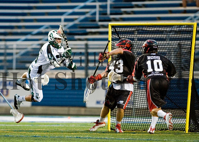 Lizards' Matt Danowski (40) makes a diving score attempt during a MLL game between the Long Island Lizards and the Toronto Nationals at the James M. Shuart Stadium in Nassau, New York.