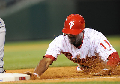 Philadelphia Phillies' Jimmy Rollins #11 gets back in a hurry after a pickoff attempt against the New York Mets at the Citizens Bank Park.