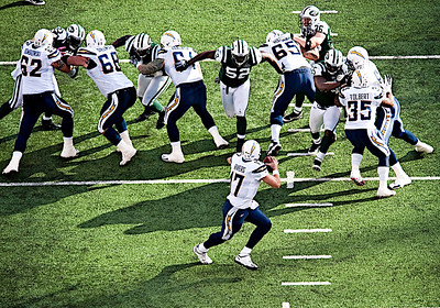 Jets' linebacker David Harris (52) blitz up the middle puts pressure on Chargers' quarterback Philip Rivers (17) in the third quarter during NFL action between the New York Jets and the San Diego Chargers at the MetLife Stadium in East Rutherford, New Jersey.