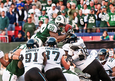 New York Jets' running back Thomas Jones (20) goes over the top for a touchdown during NFL action against the Jacksonville Jaguars at Giants Stadium in East Rutherford, New Jersey.