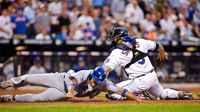 New York Mets catcher Omir Santos (9) misses the tag at home plate on Los Angles Dodgers Rafael Furcal (15).